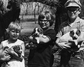 An early photograph of mine of some farm kids and their new puppies. Each child is expressing his or her personality by the way she is holding the puppy. We should encourage each person to embrace her voice and core personality and feel free to speak out with it. (C) Jane M. Mason, Minneapolis, MN. 2010.