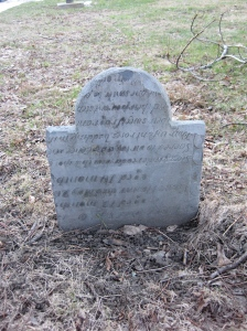 "A re-purposed headstone. The ""current"" information is on the opposite side."