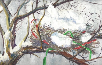 A snow-covered bird's nest tucked into the branch of a tree, with brightly colored ribbons woven into the nest.