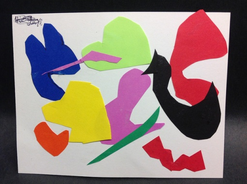 A collage of cut-out shapes in various colors and pasted on a white background.