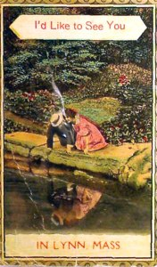 A post card with an image of two adults seeing their reflection as they kneel by the edge of a pond. From the collection of the Lynn Museum & Historical Society